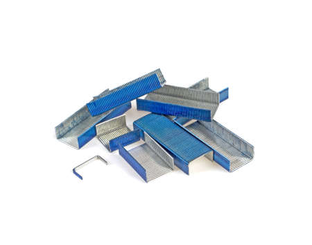 Staples for a stapler of blue color on a white background Stock Photo