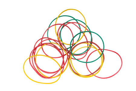 colored rubber bands for money on a white background