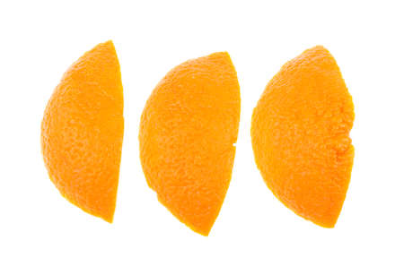 Orange zest on a white background, isolated.