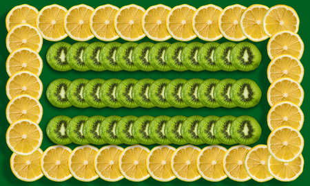 photo with a juicy lemon and kiwi cut in half on a green background. Stock fotó