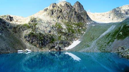 rare rocks: lake in the mountains Stock Photo
