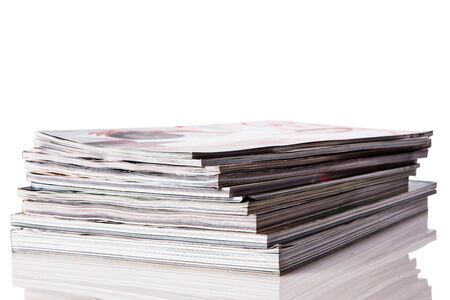 Stack of magazines isolated on white background with reflexion photo