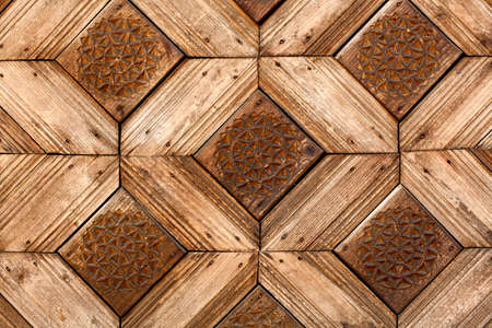 crave: wooden craved background with nails