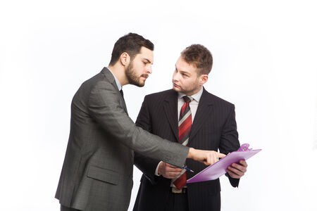collegue: businessman points a clipboard in hands of his collegue, on white Stock Photo