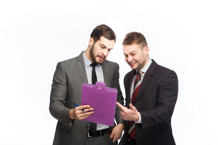 two businessmen examines a clipboard on white background Stock Photo