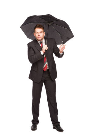 happens: elegant man with umbrella wonder what happens on white background
