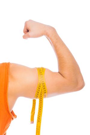 tailor measure: braccio forte con la misura di misura di nastro su bianco