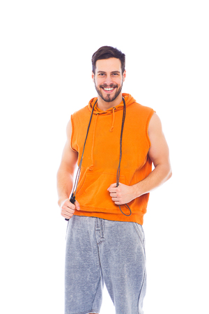 smiling man in sport clothes on white background Stock Photo