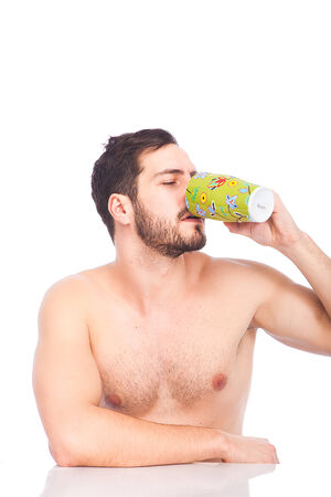handsome man drinking coffe in the morning without shirt on white photo
