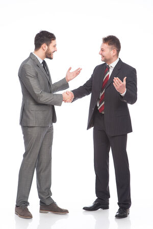 businessmans talking and shaking hands happy, on white background photo