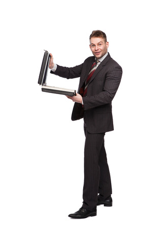 surprised businessman with an open briefcase on white background