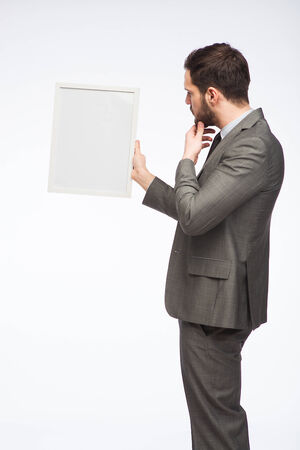 businessman looking at framed board  photo