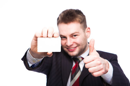 showed: close-up of a white card showed by an elegant man smiling with ok sign, isolated Stock Photo