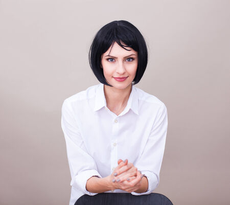leaned: standing woman in white office shirt leaned on a chair