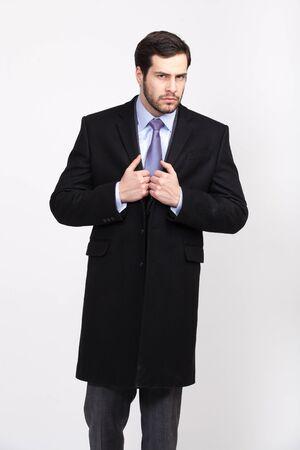 overcoat: handsome elegant man with beard in black overcoat, isolated