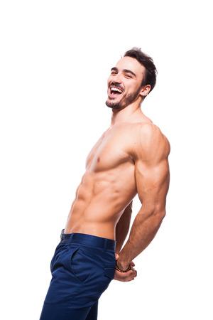 nudo maschile: sorridente uomo rilassato con atletica e un corpo sani muscolare su sfondo bianco Archivio Fotografico