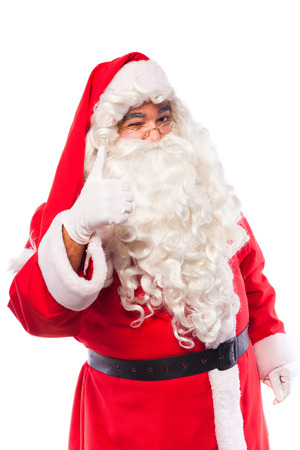 santa claus with glases and white gloves making signs with his hands on white background photo