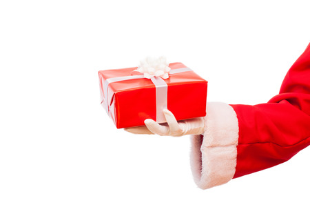 Santa Claus arm with a red christmas present photo