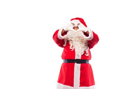 santa claus making heart sign with his hands on white background photo
