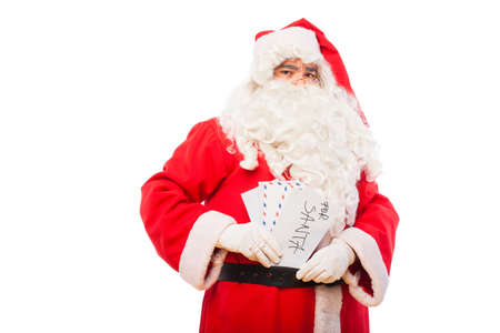 santa claus with letters for santa on his belt photo