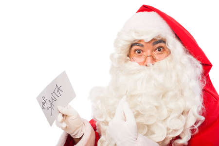santa claus holding letters from kids  on white background photo