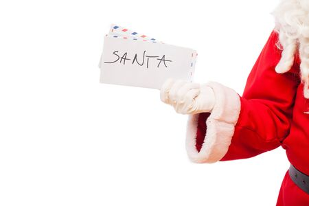 st nick: letters for santa in hand of santa on white