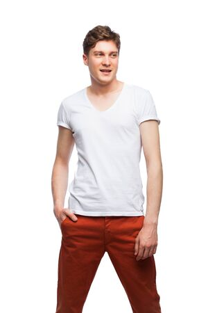 red pants: young man in white shirt and red pants isolated on white