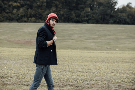 neckcloth: cool young man on a country road with field and trees