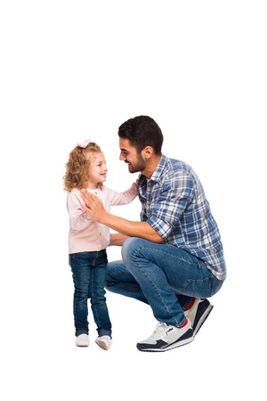 young handsome father with his little daughter isolated on white