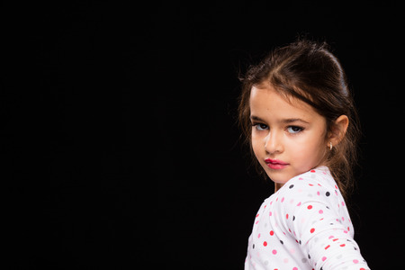 young girl: beautiful little girl pretending to be a model, playing