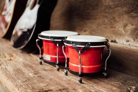 bongo: bongo drums on old wood plank
