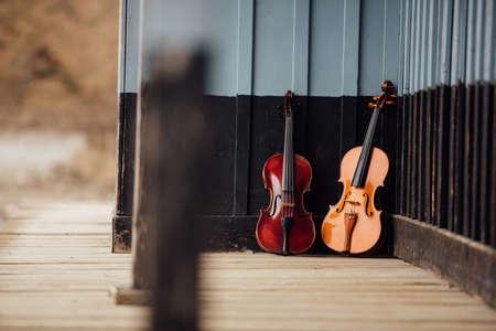 violins: violins resting on an old wooden porch