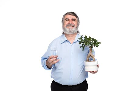 gray beard: old men with gray beard holding a small tree and glass of water in hands, isolated on white