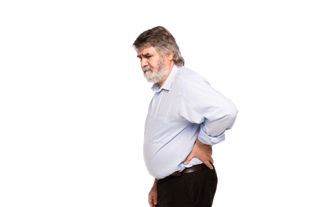 seniors suffering painful illness: old man with back pain, isolated on white