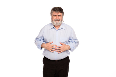 seniors suffering painful illness: old man with stomach pain, isolated on white