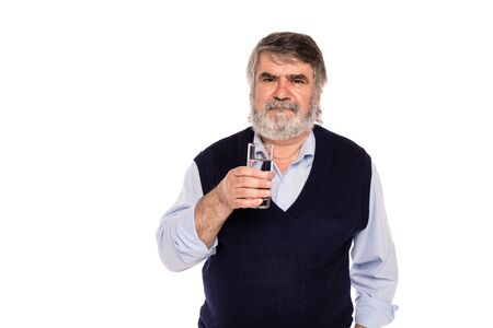 gray beard: old man with gray beard having a glass of water in hand