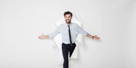 young office man with tie and breaking the paper background, presenting the background