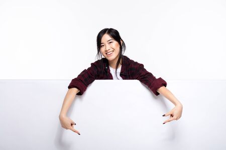 smiling cute asian young woman behind an empty white board casual dressed, isolated on white Stock Photo - 70132591
