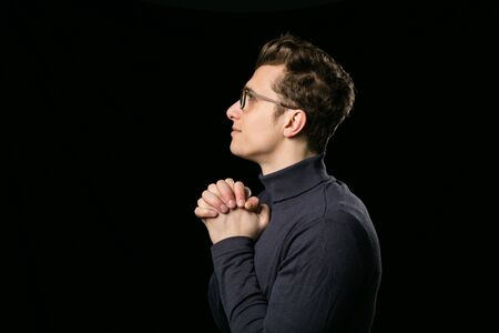 atractive: smart man with elegant glasses and neck blouse praying