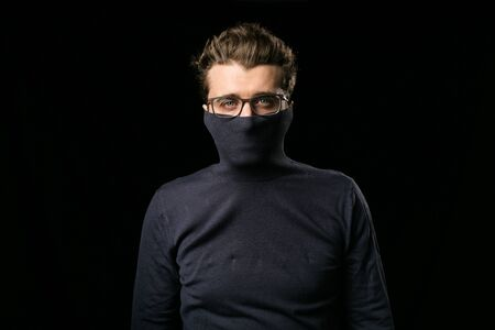 atractive: smart man with elegant glasses covering his mouth with his neck blouse
