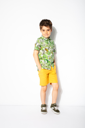 cool child posing on white background