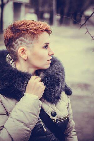 stilish: Fashion portrait of young beautiful stilish woman. Bob short hair. City lifestyle. Street fashion concept. Stock Photo
