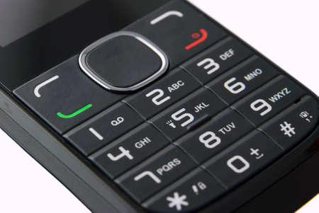 oldened: Macro keypad of a cellphone isolated on white background Stock Photo