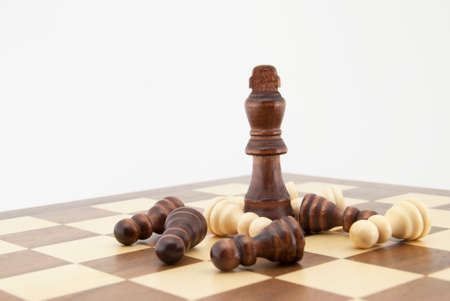 chess king: Chess king and pawns on chessboard with white background. Landscape format.