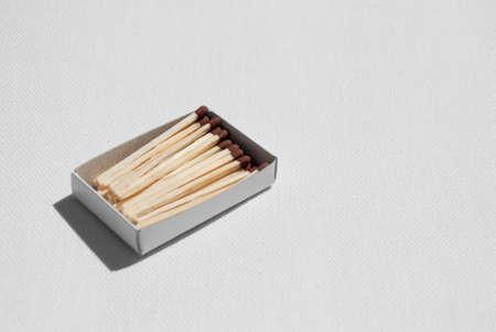 pyromaniac: Matchbox on white canvas background