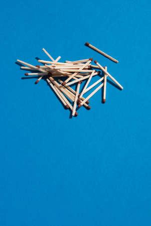 pyromaniac: Matches on light blue background Stock Photo