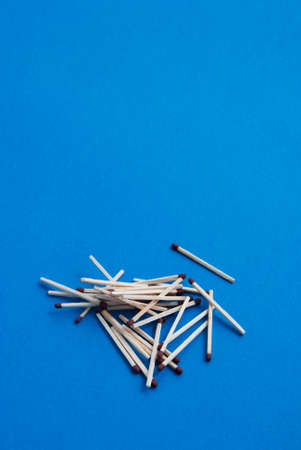 Matches on light blue background Stock Photo