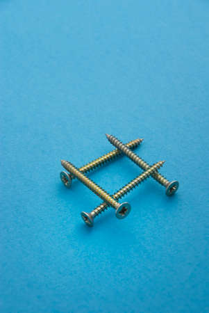 chipboard: Chipboard Screws on light blue background.  Stock Photo
