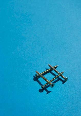 chipboard: Chipboard Screws on light blue background.  Stock Photo