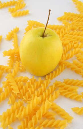 rotini: Apple and rotini pasta. Stock Photo